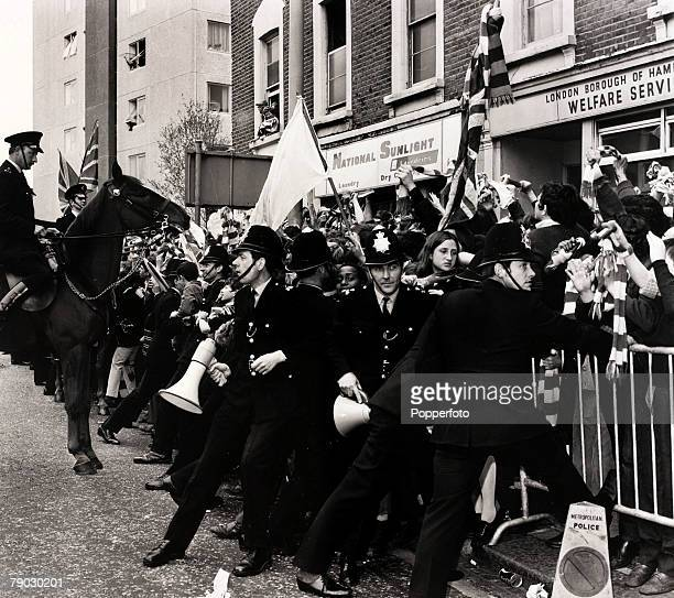Sport/Football London England 22nd May 1971 Police struggle to contain fans of Chelsea as the team arrive at Fulham Town Hall after they had won the...