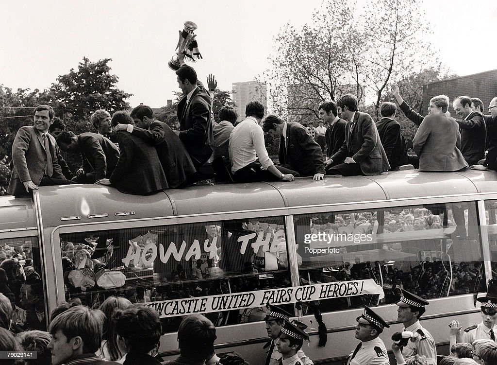 Sport/Football. Newcastle, England. 12th June 1969. Newcastle United captain Bobby Moncur holds aloft the Inter Cities Fairs Cup on the open top team bus as the team tour Newcastle the day after they had beaten Hungarian team Ujpest Dozsa 6-2 on aggregate : News Photo
