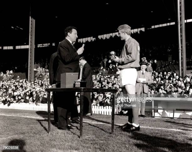 Sport/Football Old Trafford England Manchester United striker Denis Law receives his award after being chosen as the European Footballer of the Year...