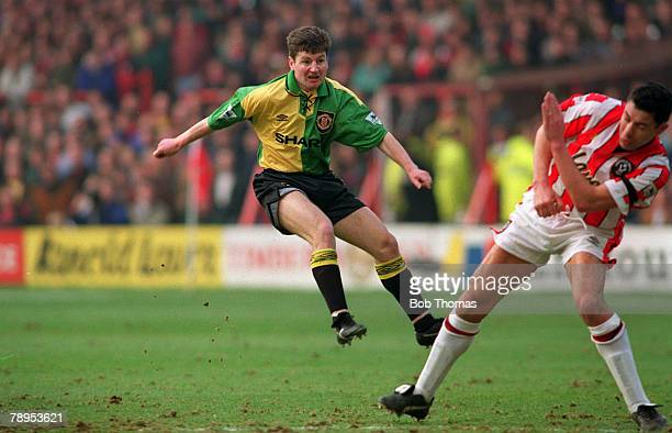 14th February 1993 FA Cup 5th Round Sheffield United 2 v Manchester United 1 Manchester United defender Denis Irwin shoots for goal as Sheffield...