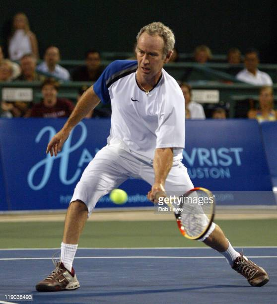 Sportimes' John McEnroe hits a return during action against Mardy Fish of the Houston Wranglers. The New York Sportimes defeated the Houston...