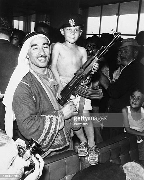 Sporting a guerrilla cap sixyearold Yaron Raab from Trenton New Jersey poses with an automatic rifle as passengers freed from hijacked jetliners...