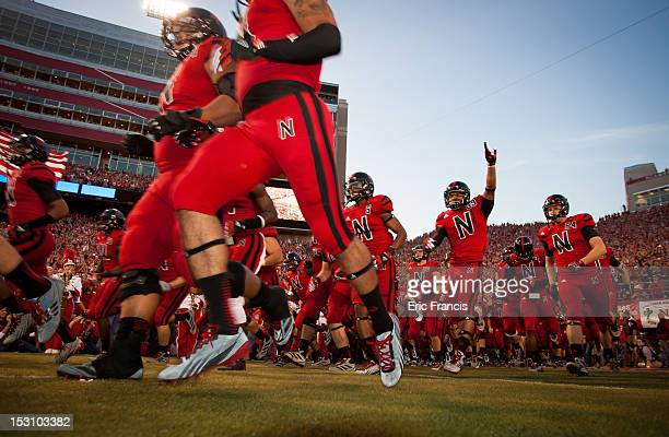 Sporting a new look uniform for their game against the Wisconsin Badgers the Nebraska Cornhuskers take the field at Memorial Stadium on September 29...