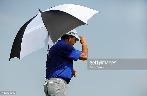 Sporting an umbrella to ward of the heat David Frost walks off the tee box on the third hole during the final round of the 3M Championship at TPC...