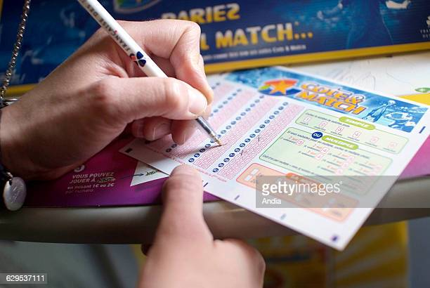Sporting betting with 'La Francaise des jeux' 'Cote et Match' sports betting ticket Game addiction Game card National lottery games of chance games...