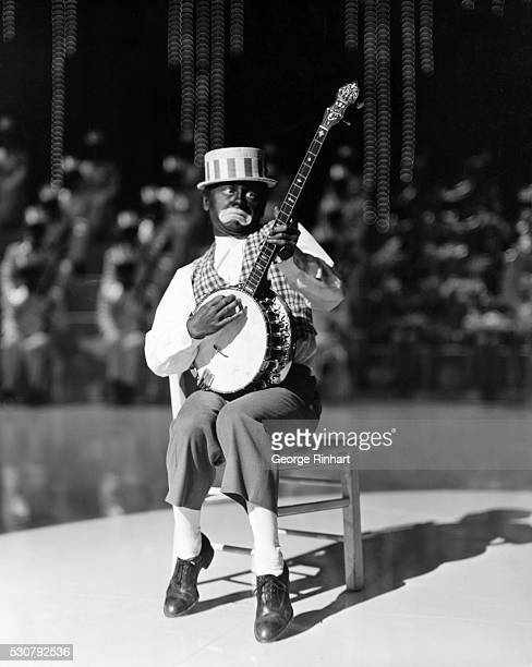 Sporting black face and playing a banjo in the minstrel show finale of MGM's 1941 musical Babes on Broadway Mickey Rooney looking rather disappointed...