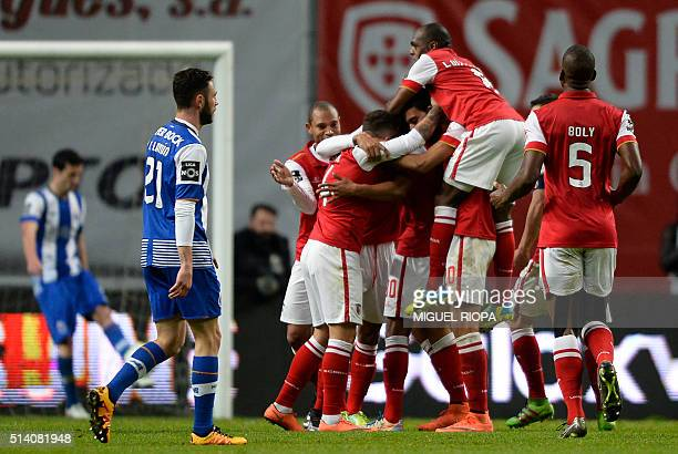 Sporting Braga players celebrate their third goal scored against Porto during the Portuguese league football match SC Braga vs FC Porto at the AXA...
