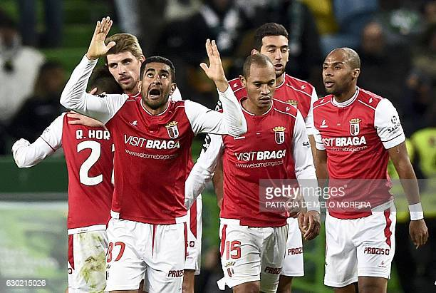 Sporting Braga's Brazilian defender Marcelo Augusto Ferreira Teixeira gestures as he celebrates a goal by forward Wilson Eduardo during the...
