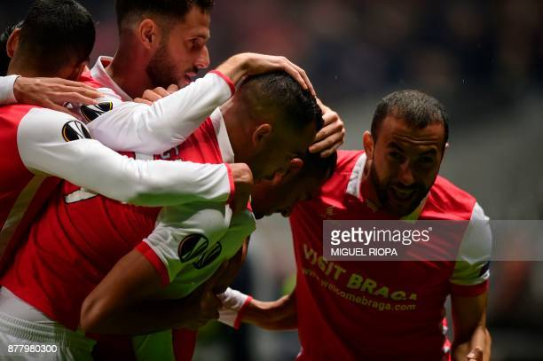 Sporting Braga's Brazilian defender Marcelo Goiano celebrates a goal with teammates during the Europa League football match SC Braga vs TSG 1899...