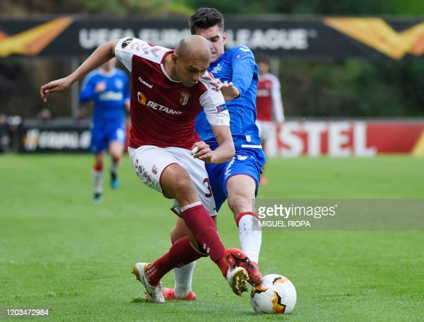 Sporting Braga's Brazilian defender Raul vies with Rangers' Romanian midfielder Ianis Hagi during the UEFA Europa League round of 32 second leg...