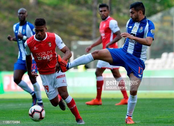 Sporting Braga's Brazilian forward Murilo Souza challenges Porto's Mexican forward Jesus Corona during the Portuguese League football match between...