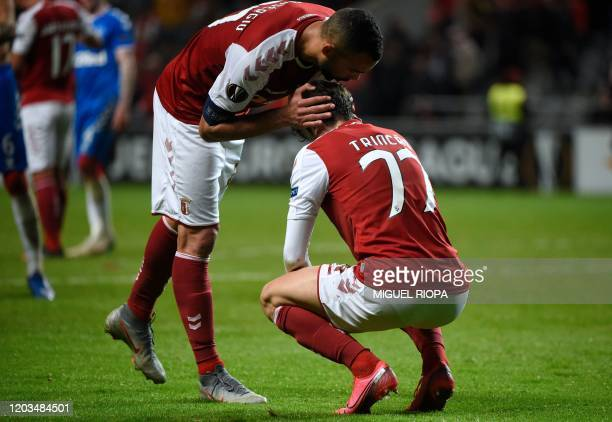 Sporting Braga's Brazilian midfielder Fransergio comforts Portuguese forward Francisco Trincao at the end of the UEFA Europa League round of 32...