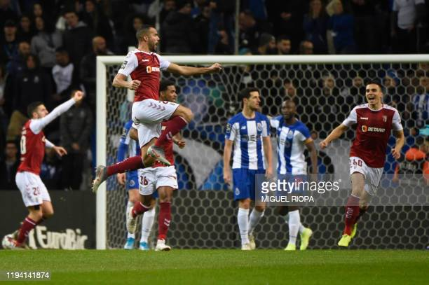 Sporting Braga's Brazilian midfielder Fransergio jumps to celebrate his goal during the Portuguese league football match between FC Porto and SC...