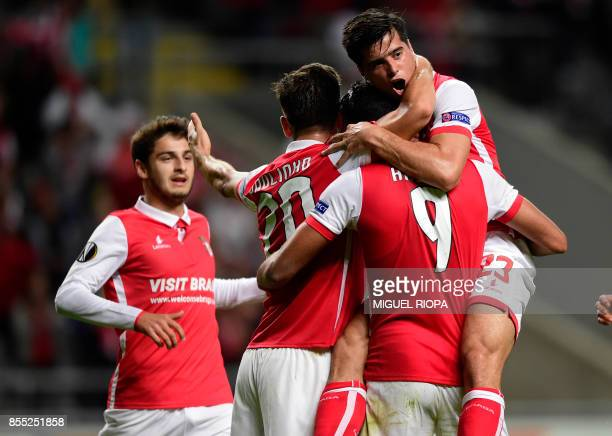 Sporting Braga's Egytian forward Ahmed Hassan celebrates with teammates after scoring the opening goal during the UEFA Europa league football match...