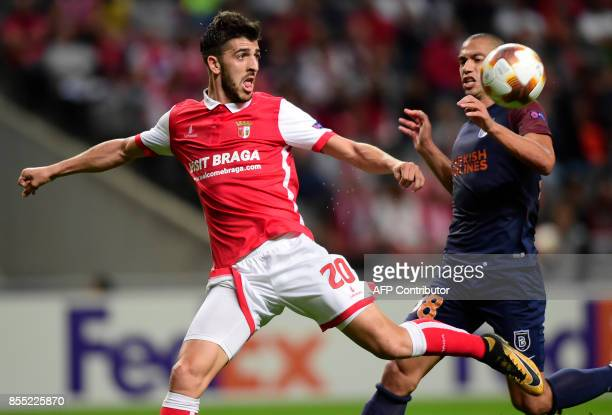 Sporting Braga's forward Paulinho vies with Basaksehir's Swiss midfielder Gokhan Inler during the UEFA Europa league football match SC Braga vs...