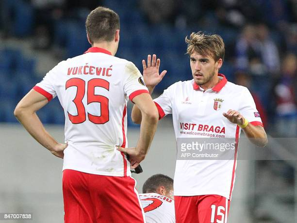 Sporting Braga's midfielder from Montenegro Nikola Vukcevic and Sporting Braga's midfielder from Portugal Andre Horta celebrate after the UEFA Europa...