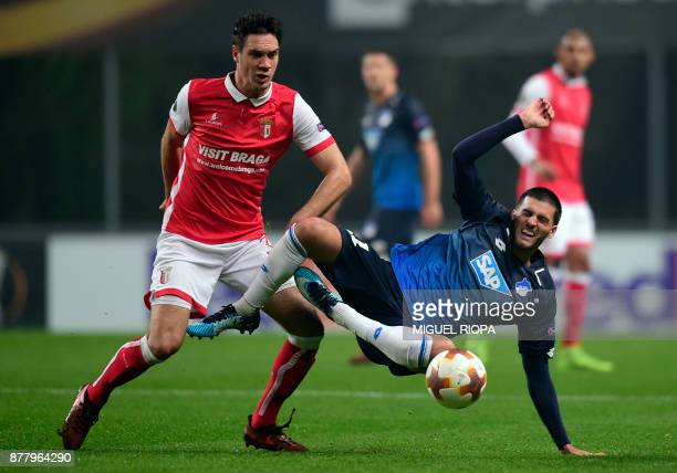Sporting Braga's Montenegrin midfielder Nikola Vukcevic vies with Hoffenheim's Austrian midfielder Florian Grillitsch during the Europa League...