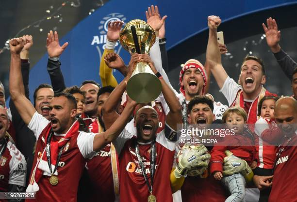 Sporting Braga's players celebrate after winning the Portuguese Taca da Liga or League Cup final football match between SC Braga and FC Porto at the...
