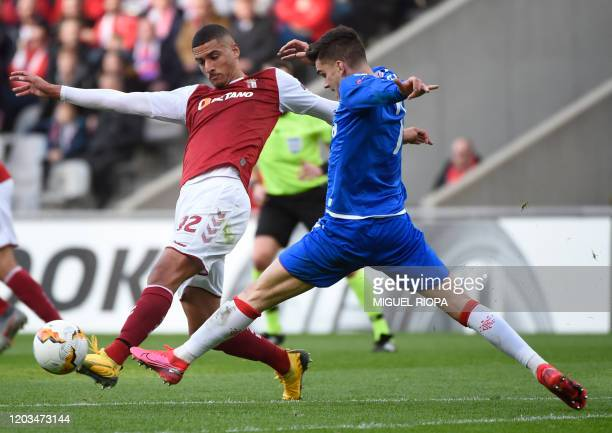 Sporting Braga's Portuguese defender David Carmo vies with Rangers' Romanian midfielder Ianis Hagi during the UEFA Europa League round of 32 second...