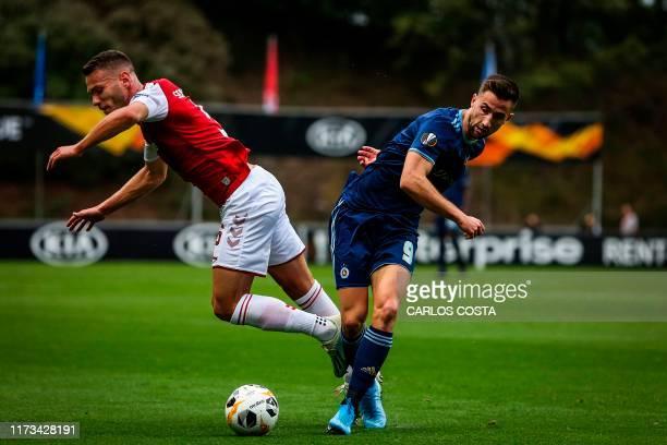 Sporting Braga's Portuguese defender Nuno Sequeira vies with Slovan Bratislava's Slovenian forward Andraz Sporar during the UEFA Europa League Group...