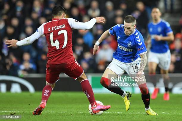 Sporting Braga's Portuguese defender Ricardo Esgaio vies with Rangers' English midfielder Ryan Kent during the UEFA Europa League round of 32 first...