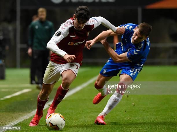 Sporting Braga's Portuguese forward Francisco Trincao challenges Rangers' Croatian defender Borna Barisic during the UEFA Europa League round of 32...