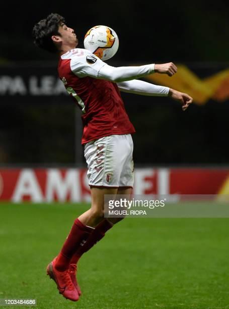 Sporting Braga's Portuguese forward Francisco Trincao controls the ball during the UEFA Europa League round of 32 second leg football match between...