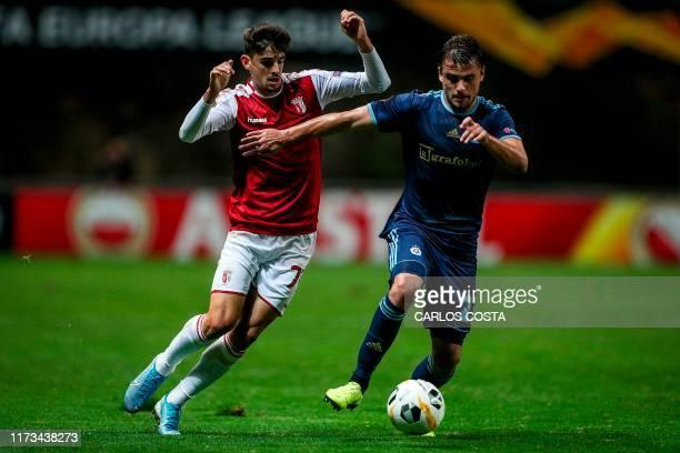 Sporting Braga's Portuguese forward Francisco Trincao vies with Slovan Bratislava's Ukrainian defender Artem Sukhotskiy during the UEFA Europa League...
