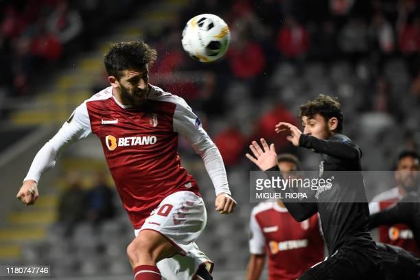 Sporting Braga's Portuguese forward Paulinho heads the ball next to Besiktas' Turkish midfielder Kartal Yilmaz during the UEFA Europa League Group K...
