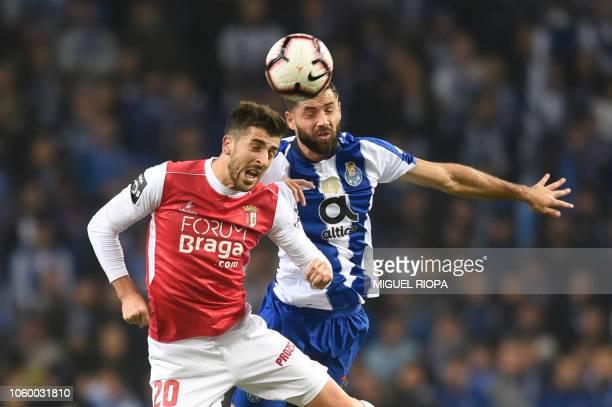 Sporting Braga's Portuguese forward Paulinho heads the ball with Porto's Brazilian defender Felipe during the Portuguese league football match...