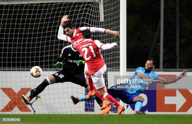Sporting Braga's Portuguese forward Ricardo Horta kicks the ball to score a goal during the Europa League Round of 32 second leg football match...