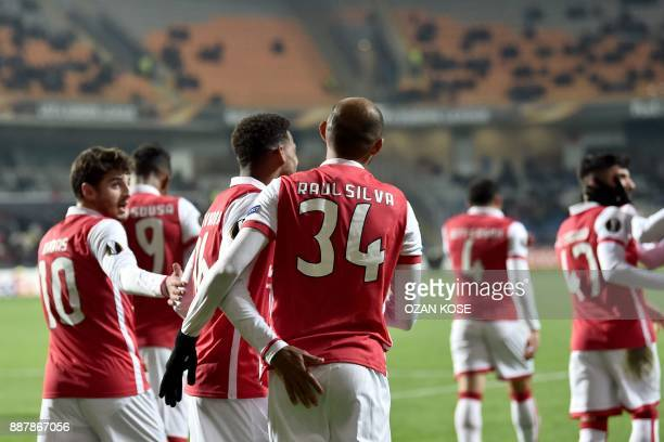 Sporting Braga's Raul Silva celebrates with his teammates after scoring during the UEFA Europa League football match Istanbul Basaksehir FK vs SC...