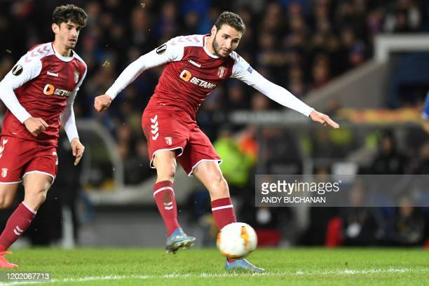 Sporting Braga's Spanish striker Abel Ruiz scores his team's second goal during the UEFA Europa League round of 32 first leg football match between...