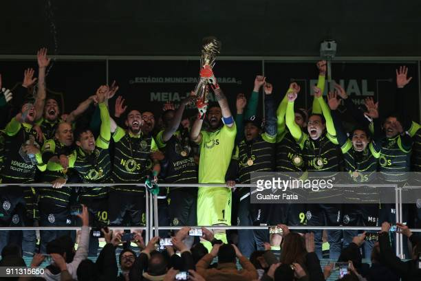 Sporting captain goalkeeper Rui Patricio from Portugal and teammates celebrate with the trophy after winning the Portuguese League Cup at the end of...