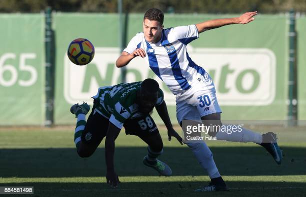 Sporting CP B defender Mauro Riquicho with FC Porto defender Diogo Dalot from Portugal in action during the Segunda Liga match between Sporting CP B...