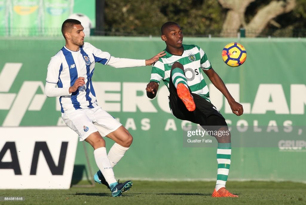 Sporting CP B forward Rafael Leao with FC Porto midfielder Rui Pires from Portugal in action during the Segunda Liga match between Sporting CP B and FC Porto B at CGD Stadium Aurelio Pereira on December 2, 2017 in Alcochete, Portugal.