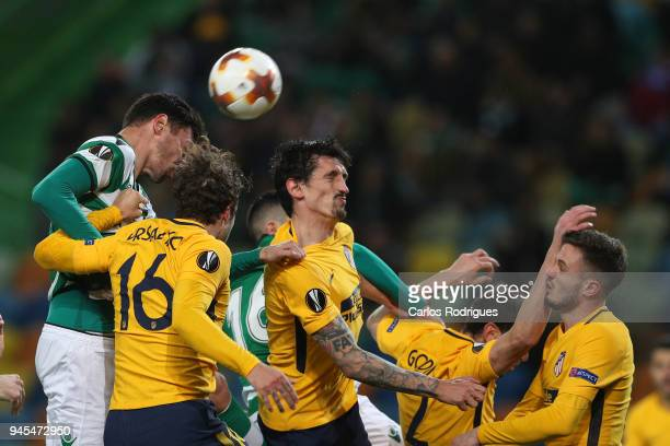 Sporting CP defender Andre Pinto from Portugal vies with Club Atletico de Madrid defender Sime Vrsaljko from Croacia and Club Atletico de Madrid...