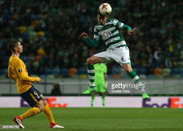 Sporting CP defender Andre Pinto from Portugal with Club Atletico de Madrid forward Fernando Torres from Spain in action during the UEFA Europa...