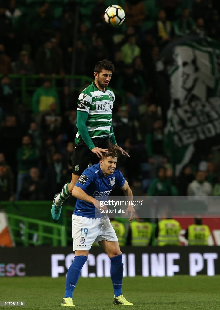 Sporting CP defender Cristiano Piccini from Italy with CD Feirense forward Joao Silva from Portugal in action during the Primeira Liga match between Sporting CP and CD Feirense at Estadio Jose Alvalade on February 11, 2018 in Lisbon, Portugal.