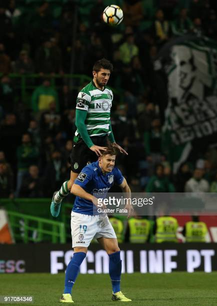 Sporting CP defender Cristiano Piccini from Italy with CD Feirense forward Joao Silva from Portugal in action during the Primeira Liga match between...