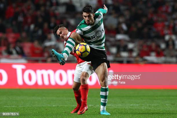 Sporting CP defender Cristiano Piccini from Italy with SL Benfica forward Franco Cervi from Argentina in action during the Primeira Liga match...