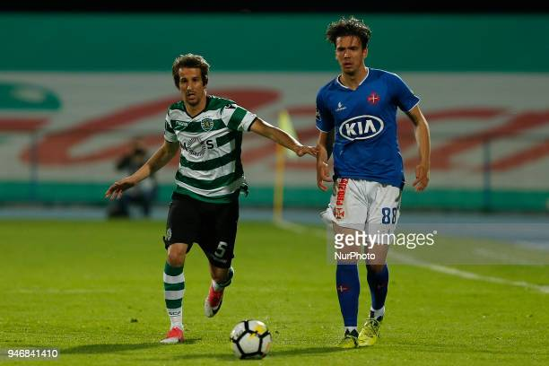 Sporting CP Defender Fabio Coentrao from Portugal and CF Os Belenenses Midfielder Marko Bakic from Montenegro during the Premier League 2017/18 match...