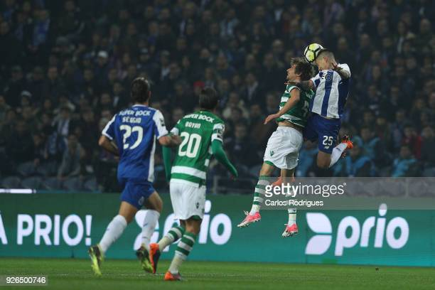 Sporting CP defender Fabio Coentrao from Portugal vies with FC Porto forward Otavio from Brazil for the ball possession during the Portuguese...