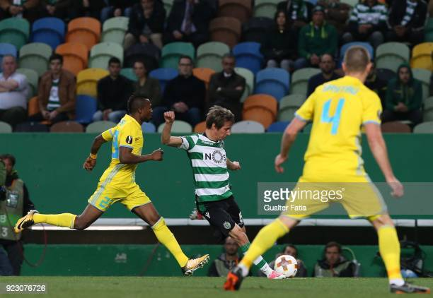 Sporting CP defender Fabio Coentrao from Portugal with FC Astana forward Patrick Twumasi from Ghana in action during the UEFA Europa League match...