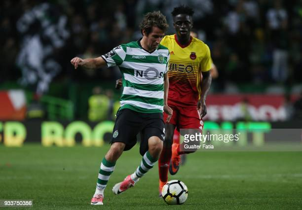 Sporting CP defender Fabio Coentrao from Portugal with Rio Ave FC defender Eliseu Nadjack from Portugal in action during the Primeira Liga match...