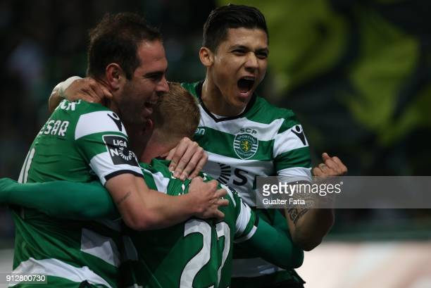 Sporting CP defender Jeremy Mathieu from France celebrates with teammates after scoring a goal during the Primeira Liga match between Sporting CP and...