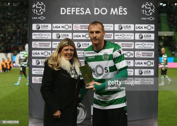 Sporting CP defender Jeremy Mathieu from France receives award for best defender in the Portuguese Primeira Liga in the month of December before the...
