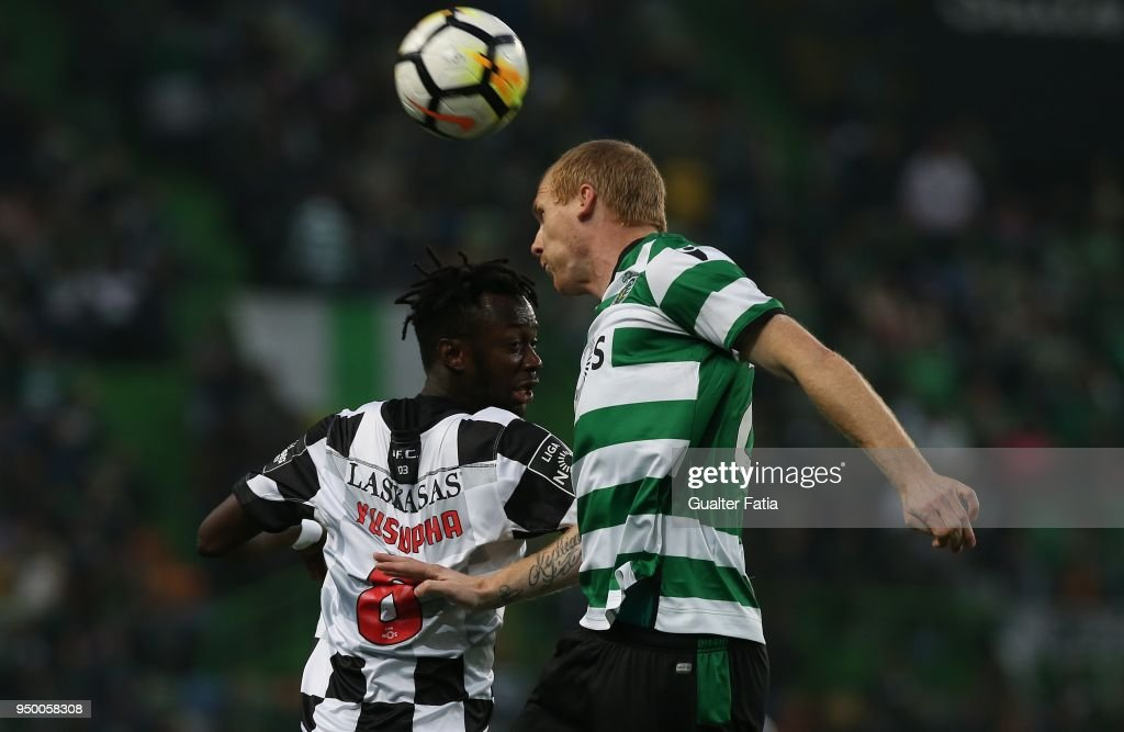 Sporting CP defender Jeremy Mathieu from France with Boavista FC forward Yusupha Njie in action during the Primeira Liga match between Sporting CP and Boavista FC at Estadio Jose Alvalade on April 22, 2018 in Lisbon, Portugal.