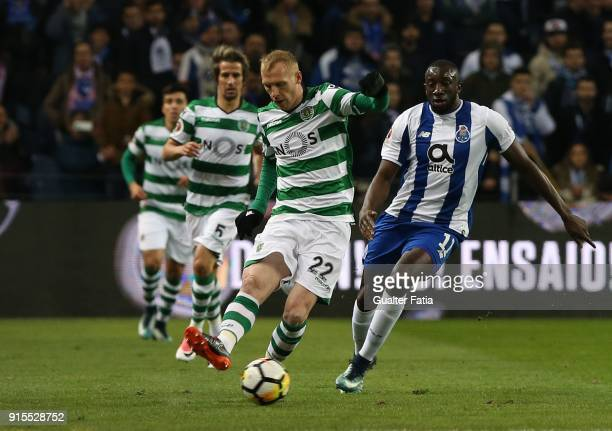 Sporting CP defender Jeremy Mathieu from France with FC Porto forward Moussa Marega from Mali in action during the Portuguese Cup Semi Final Leg One...