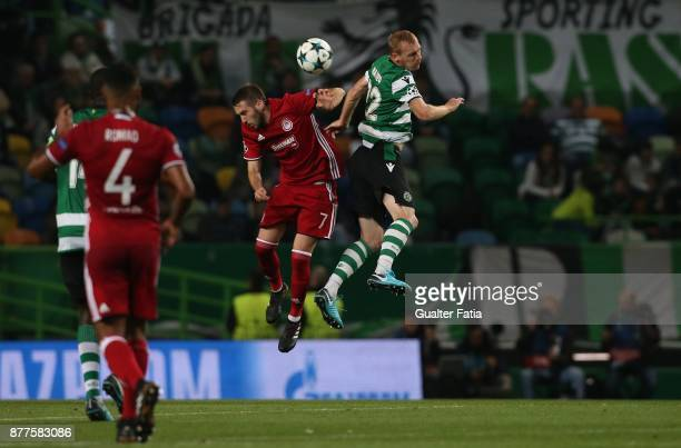 Sporting CP defender Jeremy Mathieu from France with Olympiakos Piraeus midfielder Kostas Fortounis from Greece in action during the UEFA Champions...